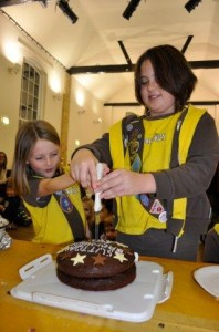 Two Brownies cutting the cake