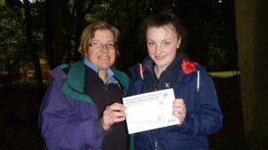 Jean presenting Anna's Baden-Powell Challenge Award